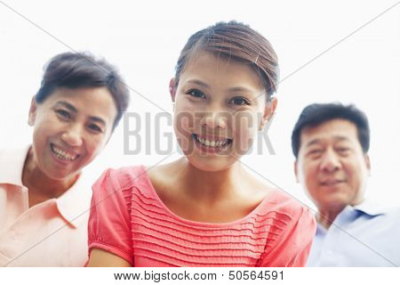 Daughter with her parents smiling, portrait