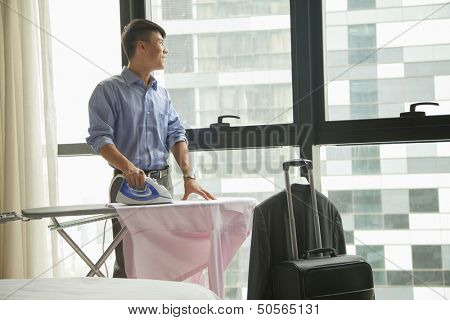 businessman ironing his shirt