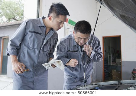 Mechanic Listening to Engine