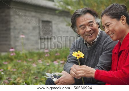 Happy Senior couple with flower