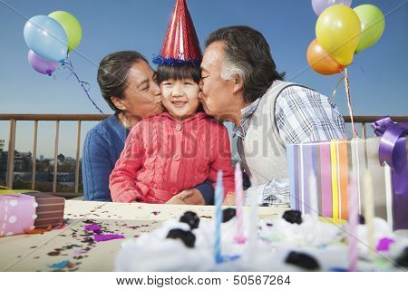 Grandparents celebrating birthday of granddaughter