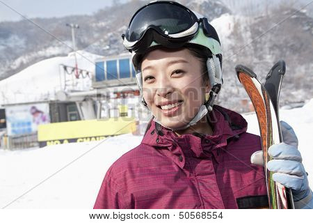 Smiling Woman in Ski Resort