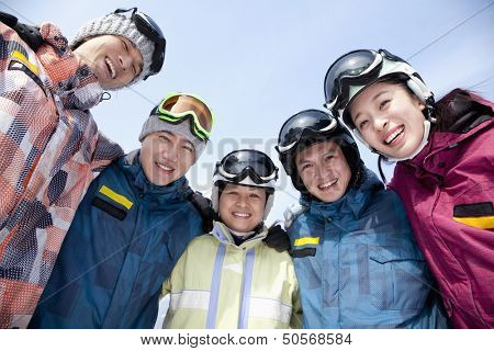 Group of Snowboarders in Ski Resort, low angle view
