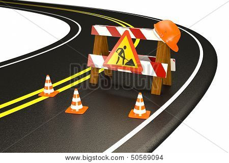 Warning of under construction on road. Barrier fence, sign and traffic cones.