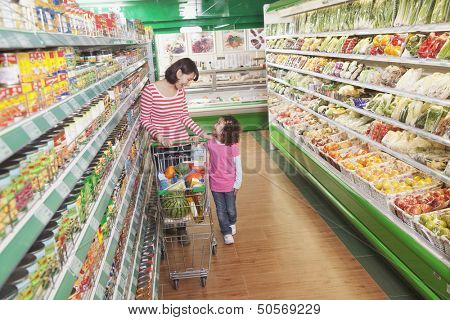 Mother and Daughter in Supermarket Shopping