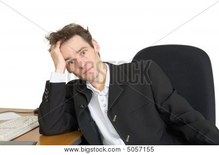 Sorrowful Businessman On A Workplace