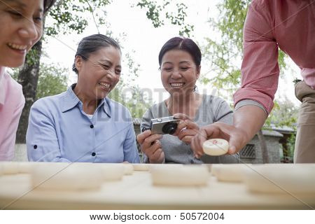Group of mature people playing Chinese checkers