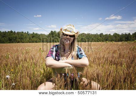 Happy Teenage Farm Girl In Wheat Field