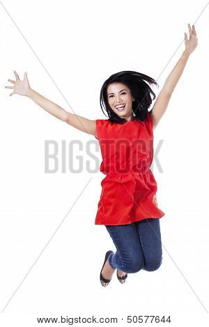 Happy Attractive Woman Jumping In The Air