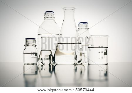 An image of some glass bottles in the laboratory