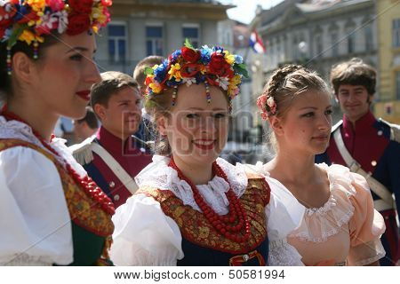 ZAGREB,CROATIA - JULY 18: Members of the ensemble song and dance Warsaw School of Economics in Polish folk costume during the 47th International Folklore Festival in Zagreb,Croatia on July 18,2013