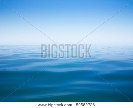 clear sky and calm sea or ocean water surface background