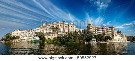 India luxury tourism concept background - panorama of Udaipur City Palace from Lake Pichola. Udaipur, India