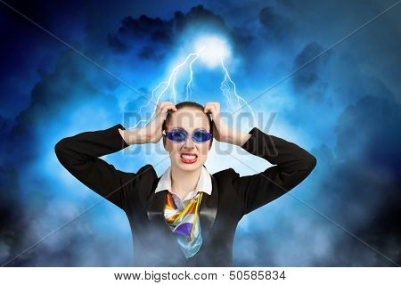 Image of irritated businesswoman in goggles with business collage at background