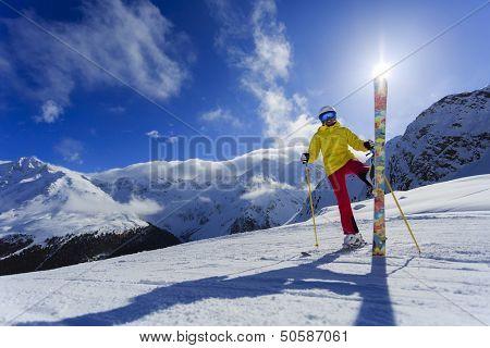 Skier, skiing, winter sport - woman has fun on ski