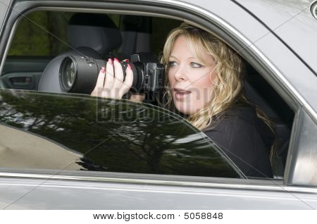 Female Private Investigator With Camera