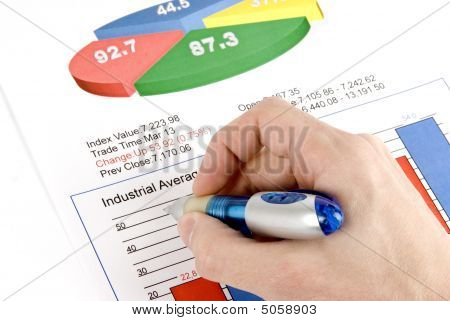 Businessman's Hand Showing Financial Diagram