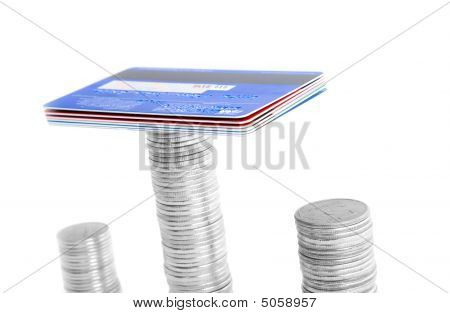 Stack Of Coins And Credit Card