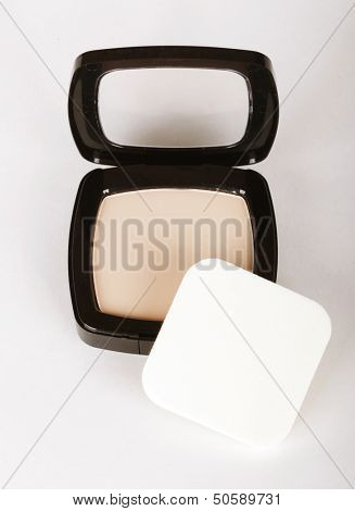 Make-up powder in box and make up brush isolated on white