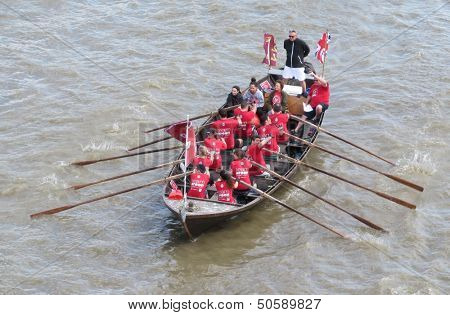 LONDON- SEPT 7: Crews rowing between tower and london bridges, visit london during river thames week, LONDON, SEPT 7, 2013