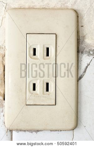 Old socket, electrical outlet. Close-up