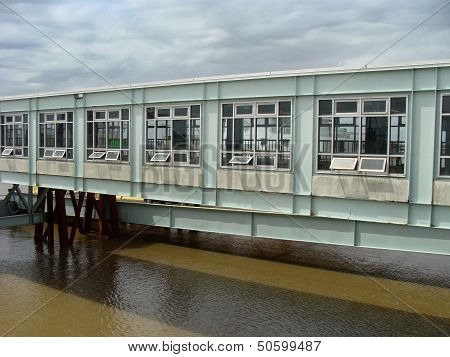 Modern bridge structure over murky water