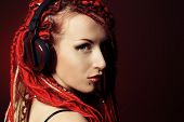 stock photo of dreadlocks  - Expressive girl in headphones with great red dreadlocks - JPG