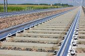 picture of railroad yard  - A Railroad track vanishing into the distance - JPG