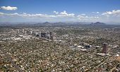 image of piestewa  - Phoenix Arizona skyline looking to the northeast including Piestewa Peak and Camelback Mountain - JPG