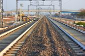 stock photo of railroad yard  - Empty Railroad track vanishing into the distance