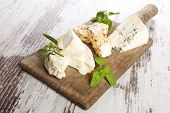 stock photo of brie cheese  - Delicious rustic style cheese still life - JPG