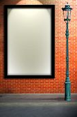image of lamp post  - Lamp post street and blank billboard on brick wall - JPG