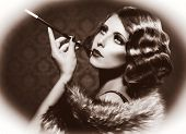 Retro Woman Portrait. Beautiful Woman with Mouthpiece. Cigarette. Smoking Lady. Vintage Styled Black