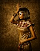 stock photo of nefertiti  - Beautiful egyptian woman bronze portrait over grunge gold background - JPG
