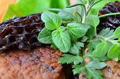 picture of morel mushroom  - Close up of pork steak with Morel mushrooms French recipe served and decorated with fresh spices  - JPG