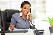 attractive female african office worker talking on phone