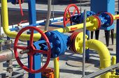 stock photo of valves  - Gas valves are on the pipes at the gas compressor station - JPG