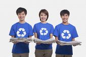 picture of medium-  length hair  - Three young people carrying newspapers - JPG