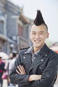 image of half-shaved hairstyle  - Young man with punk Mohawk portrait - JPG