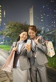 stock photo of two women taking cell phone  - Young businesswoman taking a picture of her self with her cell phone - JPG
