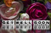 image of get well soon  - Flowers with get well soon message on reflective background - JPG
