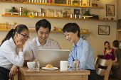 image of button down shirt  - Three friends sitting in coffee shop - JPG