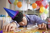 foto of office party  - Male Asleep After Party at Office - JPG