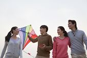 Young Friends Flying a Kite on the Beach