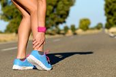 stock photo of hurt  - Sport running ankle sprain - JPG
