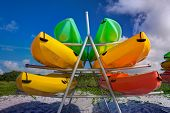 stock photo of kayak  - Rack full of Kayaks on the beach in Bill Baggs State Park in Key Biscayne - JPG
