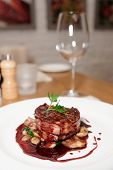 pic of chateaubriand  - Tenderloin steak wrapped in bacon on restaurant table - JPG