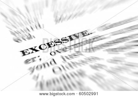 Closeup of definition of excessive from dictionary