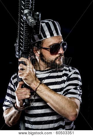 Revolt, Prison riot concept. Man holding a machine gun, prisoner