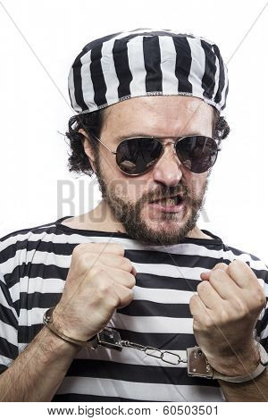 Locked, Desperate, portrait of a man prisoner in prison garb, over white background